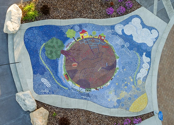 Large mosaic showing water uses and water cycles.