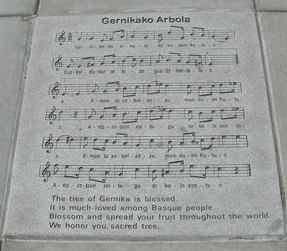 Sidewalk engraved with the 'Gernikako Arbola' song in the Basque Block.